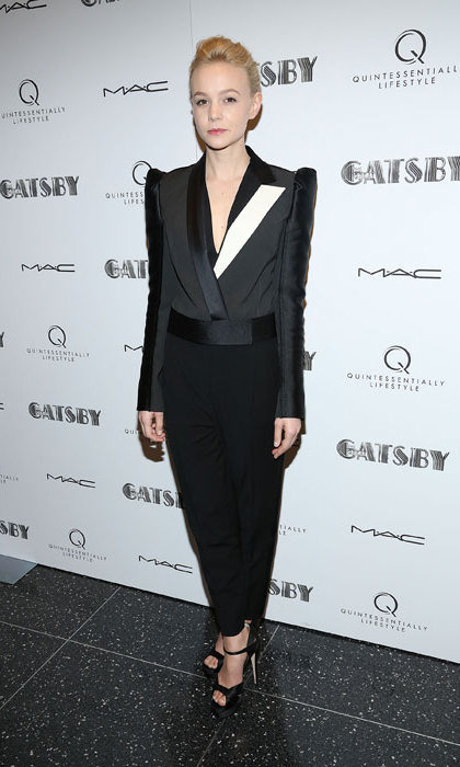 <p>Carey Mulligan wore a gorgeous black Lanvin tuxedo with padded shoulders at a special screening of <em>The Great Gatsby<em>, in which she starred opposite Leonardo DiCaprio. <p>