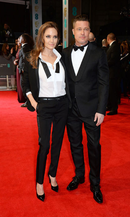 <p>Angelina Jolie and Brad Pitt turned heads at the 2014 EE BAFTAs when they showed up wearing matching tuxedoes. Angelina's tuxedo was by Yves Saint Laurent, handmade by the brand's creative director Hedi Slimane. <p>