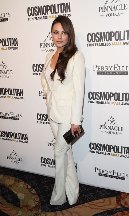 Mila Kunis wowed in an all-white tailored tuxedo suit, paired with Caleo earrings and Dana Rebecca Designs necklace while attending an event in 2011.