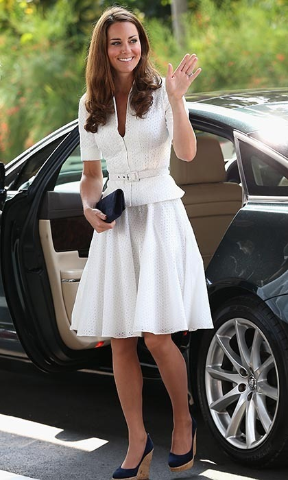 On the second day of the Diamond Jubilee tour, the newlyweds stopped off at the Gardens by the Bay park in Singapore, where the Duchess wowed in a white, short-sleeved Alexander McQueen suit. Despite telling a female fan that sheworried her hair would frizz in the humidity, Kate looked sleek and elegant.  (Photo: © Chris Jackson - Pool/Getty Images)
