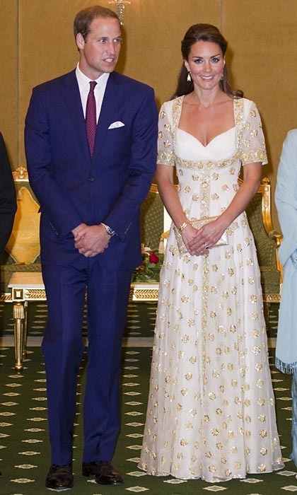 Kate slid into a spectacular gold-and-white gown for an official dinner with Malaysia's Head of State. She paired the custom Alexander McQueen number, which featured hibiscus flowers - the national blossom of Malaysia - with gold drop earrings and a delicate gold bracelet, and was gifted with quite a bit of fashionable loot: Black lace Lewre heels, a batik dress, a clutch and more. (Photo: © Mark Large - Pool/Getty Images)