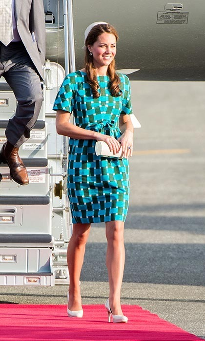 Hello Honiara! The Duchess of Cambridge touched down in the Solomon Islands looking every inch the British royal. She paired an elegant blue-and-green shift byJonathan Saunders, cinched at the waist, with white accessories - pumps, a clutch and a headpiece. (Photo: © Samir Hussein/WireImage)