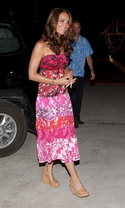 "Arriving to a dinner at the Governor General's house in Honiara, Kate seemed to havesartorially settled into island living - though she and William would laterdiscover that her strapless, tropical-printed frock and his blue ""Hawaiian"" shirt were actually traditional of the Cook Islands, not the Solomon Islands. (Photo: © Chris Jackson/Getty Images)"