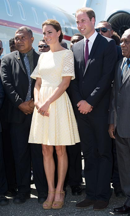 The world's eyes lit up yet again when Kate made another appearance at Honiara International Airport with William, on their way to Tuvalu. Her style is definitely consistent for a reason: The Princess looked radiant in another full-skirted eyelet confection by an independent designer, this time in a delicate cream colour. (Photo by Samir Hussein/WireImage)