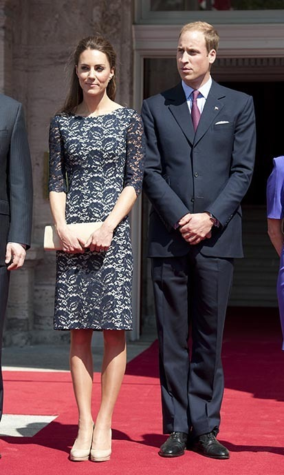 NORTH AMERICA: For the first day of their North American tour, the newlyweds attended a wreath-laying ceremony at Rideau Hall in Ottawa. Kate wore a dress by Canadian designer Erdem with her trusty L.K Bennet heels, while William donned a dapper navy-blue suit and a fuchsia tie. (Photo: © Photo Samir Hussein/WireImage/Getty Images)
