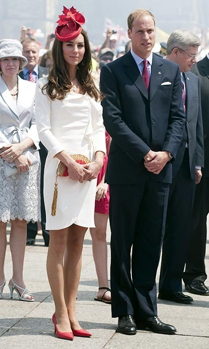 On day 2, the royal couple partook in Canada Day celebrations on ParliamentHill. Kate delighted the crowds by wearing Canada's national colours, pairing her white dress with red L.K. Bennett heels and a jaunty Sylvia Fletcher at Lock and Co. hat that featured a maple leaf emblem. Prince William coordinated with his wife by sporting a festive red tie. (Photo: © Mark Large - WPA Pool/Getty Images)