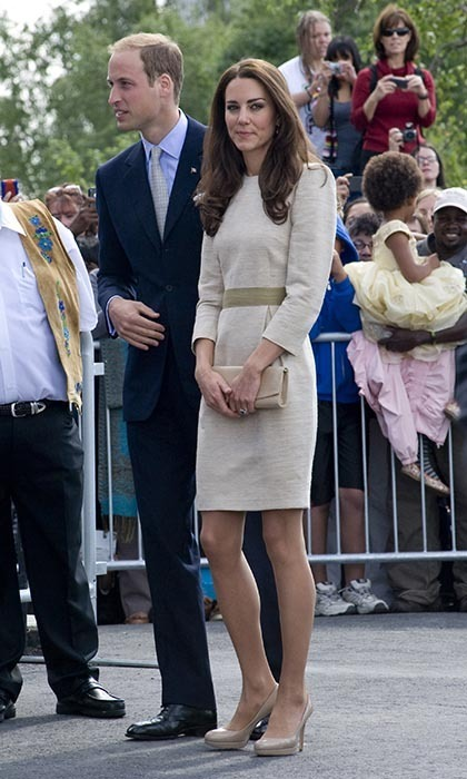For a trip to Yellowknife's Somba K'e Civic Plaza on July 5, Kate looked chic in a linen dress by Malene Birger. William,meanwhile, was handsome in a dark suit and a grey-green tie that matched his wife's belt. (Photo: ©  Samir Hussein/WireImage)