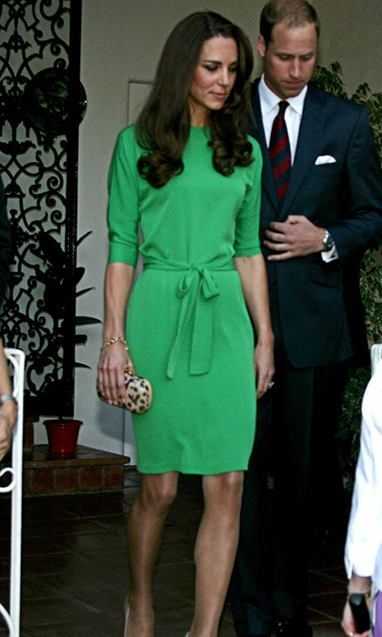 For the evening's reception at the British consul's home, Kate slipped into a green silk Diane von Furstenberg dress, which she paired with a leopard-print clutch. William wore a dark suit and a striped tie. (Photo: © BEImages/BEImages/KEYSTONE Press)