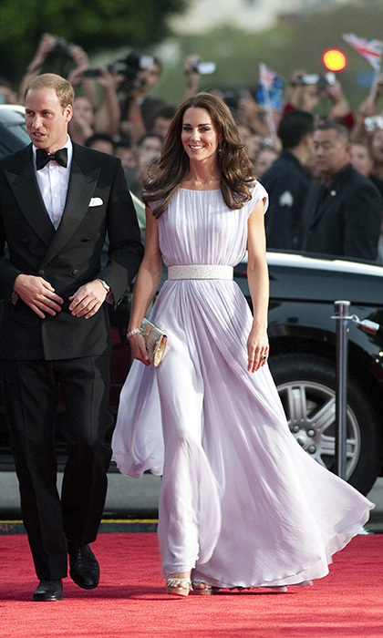 The Duke and Duchess made an elegant pair as they arrived at the BAFTA Brits in Los Angeles on July 9. Kate wore a romantic Alexander McQueen dress and diamond earrings lent to her by the Queen, while her handsome husband donned a black tuxedo and an oversized bow tie. (Photo: © Mark Large/PA/CP)