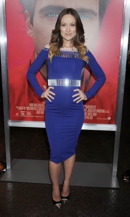 The actress showed off her growing bump in a tight David Koma dress at the premiere of the film <i>Her</i> in Los Angeles. 