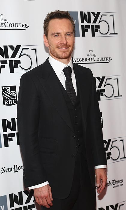 "In '12 Years a Slave' he plays a brutal plantation owner, but in real life, Michael Fassbender is a total softie. The actor is so well loved, in fact, that his adoring fans even have their own monikers (dubbed ""Fassinators""). (Photo by Astrid Stawiarz/Getty Images)"