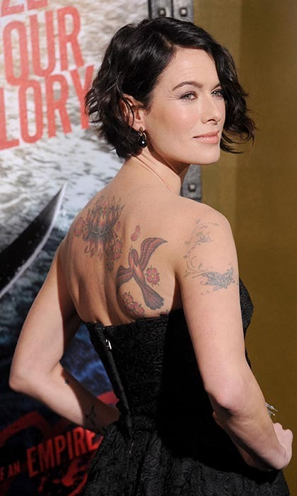 Offscreen, actress Lena Headey takes a more low-key approach to her look. The tattooed actress sports a short, dark hairstyle and opts for understated fashions on the red carpet.