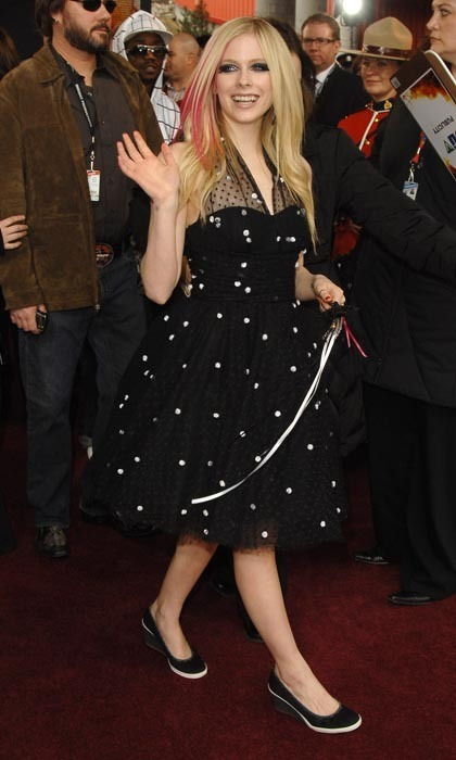 Avril Lavigne has long been synonymous with pop-punk and a youthful, fun approach to red carpet dressing. At the 2006 Junos, Avril showed off her vibrant joie de vivre by pairing a rock-and-roll polka dot dress with sneaker-inspired, black-and-white wedges.  (Photo: George Pimentel/WireImage/Getty Images)