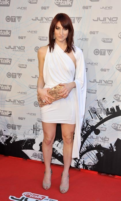Singer Hannah Georgas exuded ethereal drama on the red carpet at the 2011 Juno Awards. Her elegantly draped white short dress seemed never-ending, thanks to a shoulder-flung cape of pristine white jersey. (Photo: George Pimentel/WireImage)