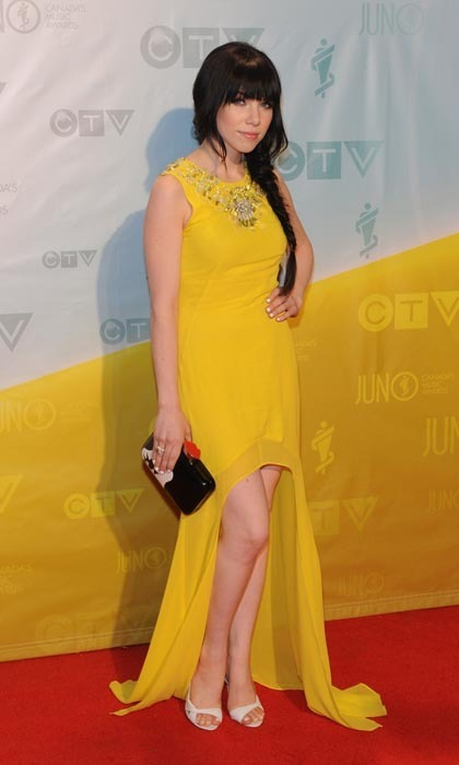 """Call Me Maybe"" singer Carly Rae Jepsen was as cute as she was stylish in sunny ASOS at the 2013 Juno Awards, pairing her lemon-hued mullet dress with a contemporary 'Marcel Wave Doll Face Fifi' clutch, courtesy of Lulu Guinness. (Photo: Jag Gundu/Getty Images)"