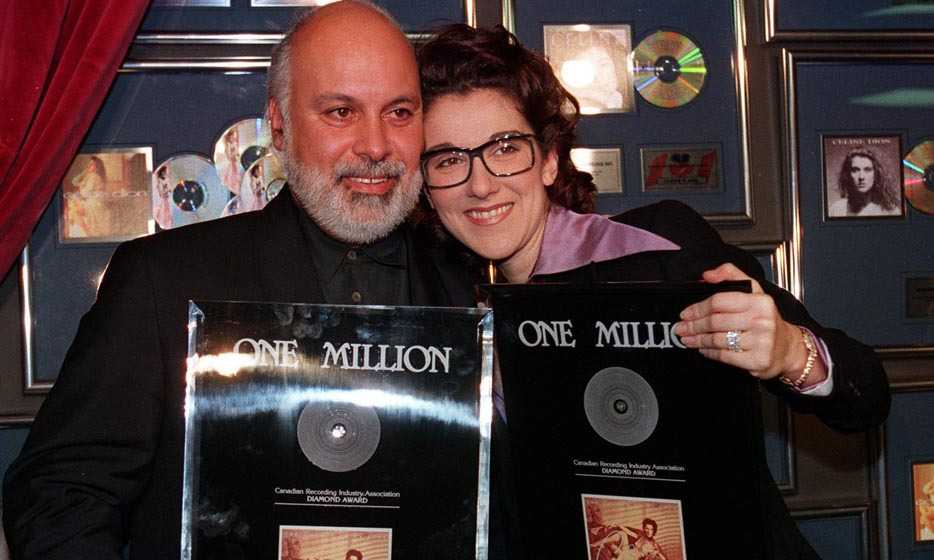 Cuddling up to her manager and fiancé, René Angélil, the singer was presented with a diamond record for 'The Colour of My Love' in Montreal. The album sold more than one million copies in Canada and six million copies worldwide. (Photo: © CP)