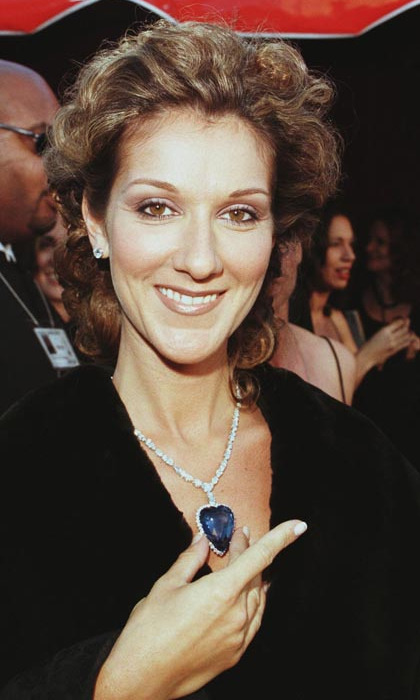 "Wearing a replica of the blue, heart-shaped diamond that was made famous in the movie 'Titanic' – for which she sang the Oscar-winning theme song, ""My Heart Will Go One – Celine made a striking entrance at the 70th annual Academy Awards. (Photo: © Getty)"