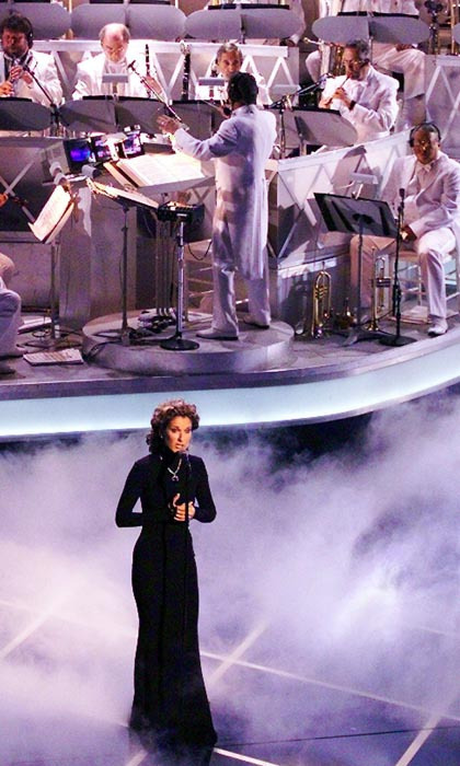 "Celine delivered a powerhouse performance of ""My Heart Will Go On"" during the award show that evening. She would later take home the Oscar for Best Original Song. (Photo: © Getty)"