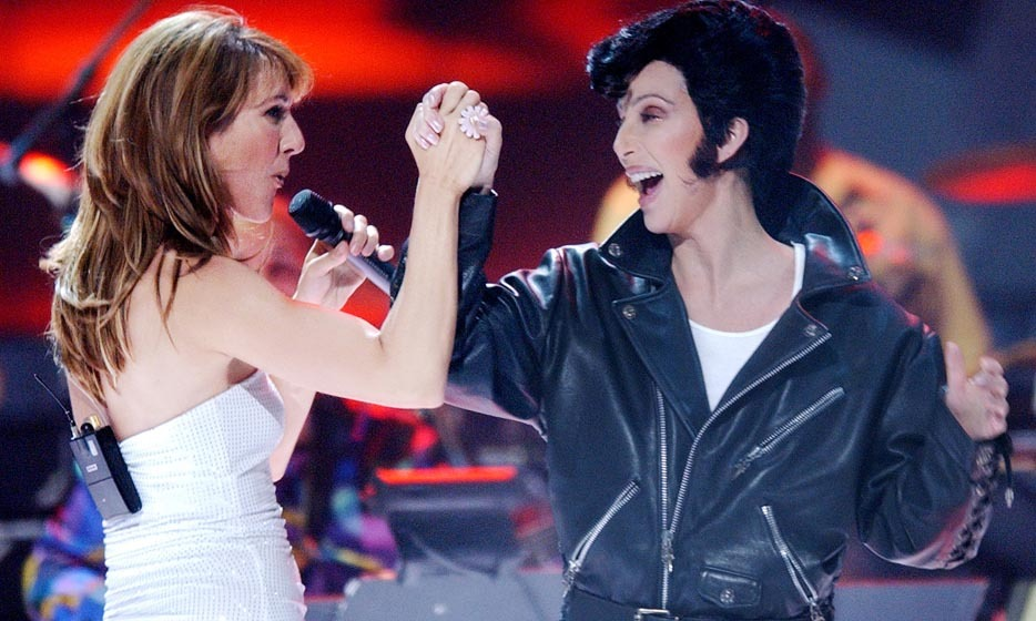 Divas squared: Celine teamed up with Cher – who dressed up as Elvis Presley! – for a raucous Vegas performance in 2002. (Photo: © Getty)