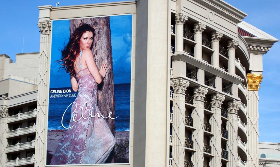 A huge Celine Dion concert poster was hung on the side of Caesars Palace in Las Vegas preceding her show. The singer performed more than 300 concerts a year at the resort starting March 25, 2003. (Photo: © Getty)