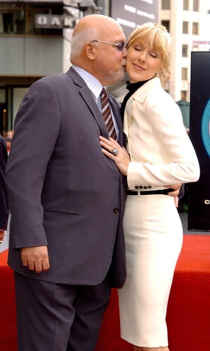 René planted a kiss on his wife's cheek after she was honoured with a star on the Hollywood Walk of Fame in 2004. (Photo: © Getty)
