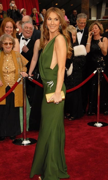 The singer was a vision in green at the 2007 Oscars, wowing the red carpet crowd in a vintage James Galanos gown with a jewel accessory at the hip. (Photo: © Getty)
