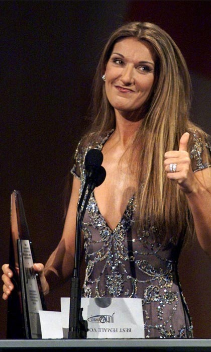 <p>Tres bien, Celine Dion. Celine mugged for the cameras with a happy thumbs up after winning Best Female Vocalist at the 1999 Juno Awards. She remains one of the most recognizable Canadian singers in power-ballad history.</p>
