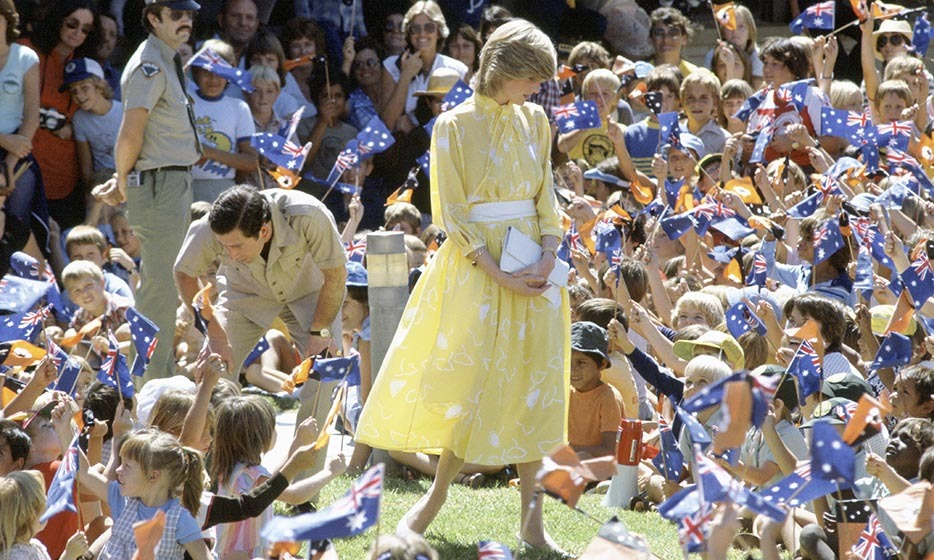 Prince Charles donned an outback-friendly ensemble while his wife (then a new mom!) was a ray of sunshine meeting school children in Alice Springs.