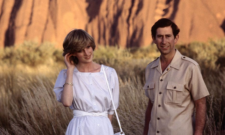 Diana and her prince posed in front of Ayer's Rock, a UNESCO World Heritage Site, on Mar. 21, 1983 near Alice Springs. Diana looked fresh as a daisy in a shirt-dress (much like what Duchess Kate favours today!) designed by Benny Ong.
