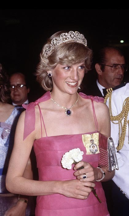 Diana got dolled up again for a reception at the Crest Hotel in Brisbane on Apr. 10, 1983, bedecking herself in Saudi sapphires and her Spencer Family tiara. Prince William's mom paired her bling with a delicate, pink gown by Victor Edelstein that featured bow detailing on the shoulders.