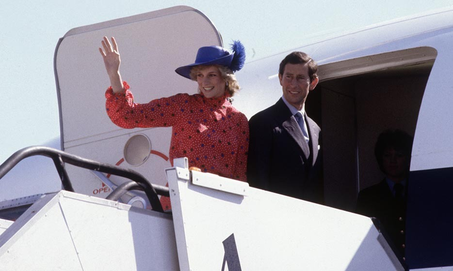 Bye! Diana, Princess of Wales, and Prince Charles wave goodbye as they leave Melbourne Airport on Apr. 17, 1983 in Melbourne at the end of their first Royal Tour to Australia. Diana looked just about as chic as a traveller could in her royal blue feathered chapeau.