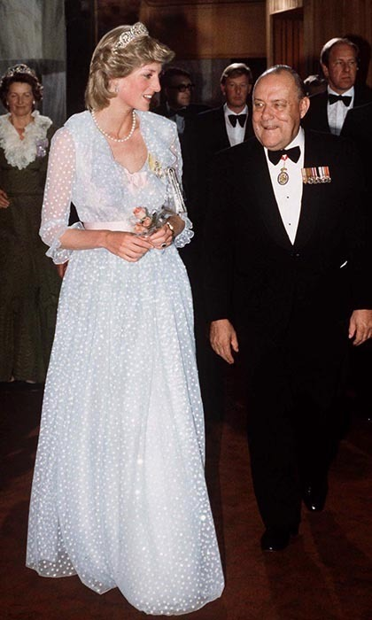 That night, Princess Diana took a stroll with Prime Minister Robert Muldoon at Parliament House. She wore her tiara for a third time with an airy, ethereal baby-blue gown designed by her constant collaborators, David and Elizabeth Emanuel.