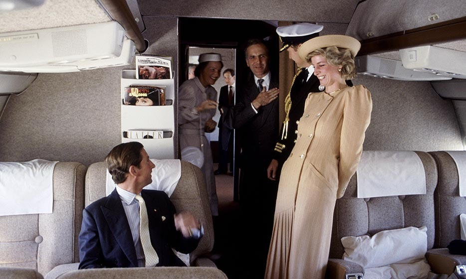 On a royal flight to Australia in October 1985, the Prince And Princess Of Wales shared a laugh with their staff.