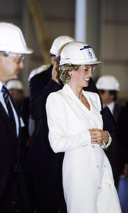 The laughs didn't stop as the couple toured an aluminum smelting plant, where Princess Diana giggled at Prince Charles while wearing a builder's hard hat and a pinstripe coat dress.