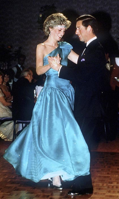 Princess Diana and Prince Charles took a spin around the dance floor at a ball held at the Southern Cross Hotel in Melbourne, 1985. Creative Diana is wearing a diamond-and-emerald choker, another wedding gift from the queen, as a headband, and a turquoise one-shoulder evening gown designed by the Emanuels.