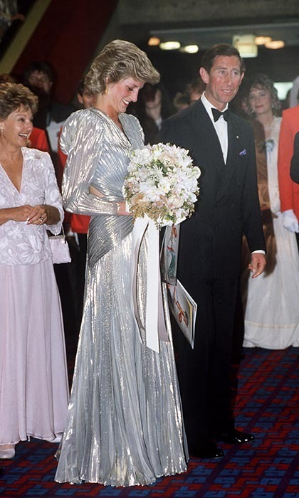 Prince Charles with Princess Diana, wearing a shimmering silver-lame backless dress by Bruce Oldfield, attended the world premiere of the film 'Burke And Wills' on Nov. 1, 1985 in Melbourne.