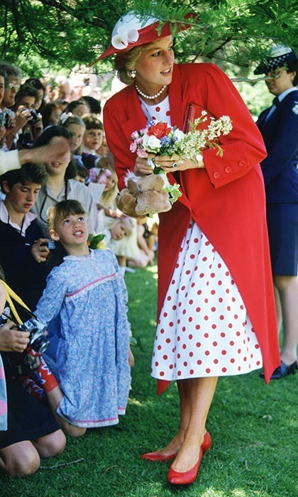 Diana, Princess of Wales receives flowers from well-wishers during a visit to the Royal Botanical Gardens in Melbourne, Australia on her 1985 royal tour.