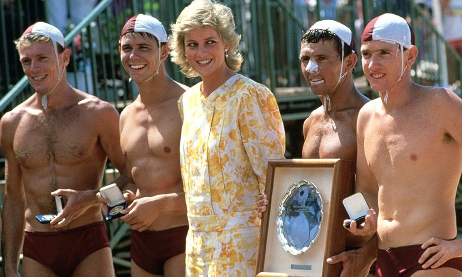 Don't blush! Princess Diana found herself surrounded by men in speedos as she presented a prize to the winning team of lifeguards at the Central Coast Surf Carnival at Terrigal Beach, Australia in 1988.
