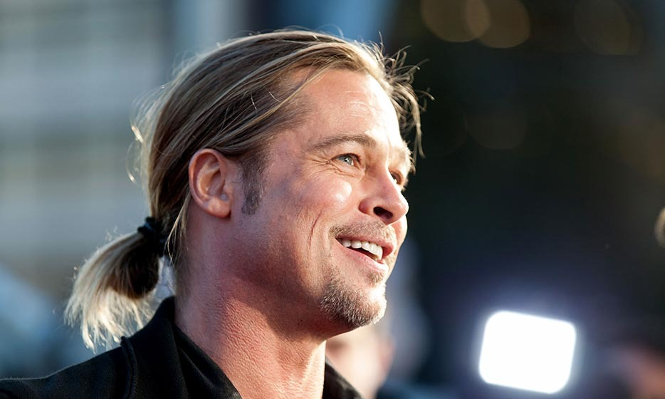 It all started in 1994, when Brad Pitt played a tender-hearted vampire with a sleek, straight 'tail. Between roles the superstar has debuted every incarnation of bun and pony ever since, including this messy number at the World War Z premiere in Australia.