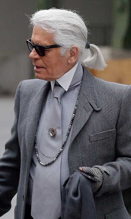 King of the silver-fox style, Karl Lagerfeld matched his entire ensemble to his greyed locks while chatting with actresses prior to his Spring-Summer 2014 show in Paris. Really, who else could kill it with such a voluminous and hoary mane?