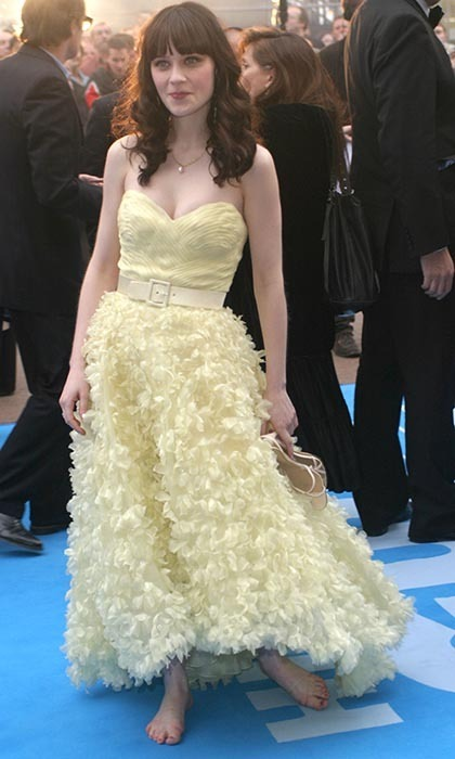 Zooey Deschanel, perpetual quirky girl, walked the red carpet for 'Hitchhiker's Guide to the Galaxy' in London's Leicester Square wearing a ruffled pale-yellow dress and no footwear.