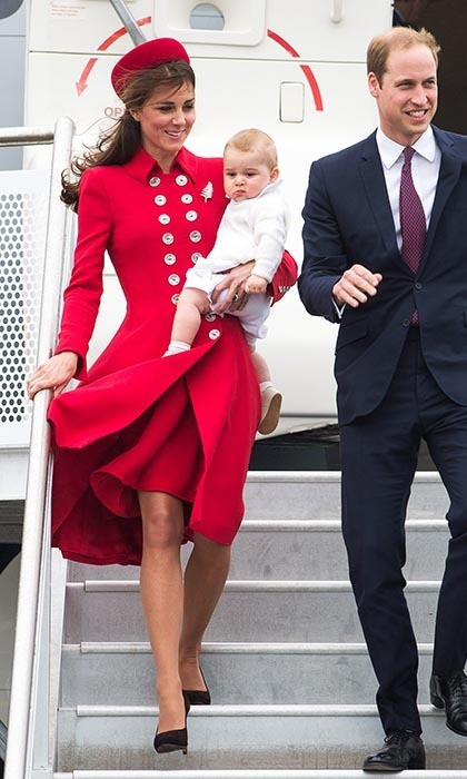 DAY 1: Kate certainly knows how to make an entrance! The Duchess was ravishing upon her arrival on New Zealand soil, sporting a red Catherine Walker coat (a favourite designer of Diana!) with double rows of gold buttons and a matching Gina Foster pillbox hat. Photo: © Getty.