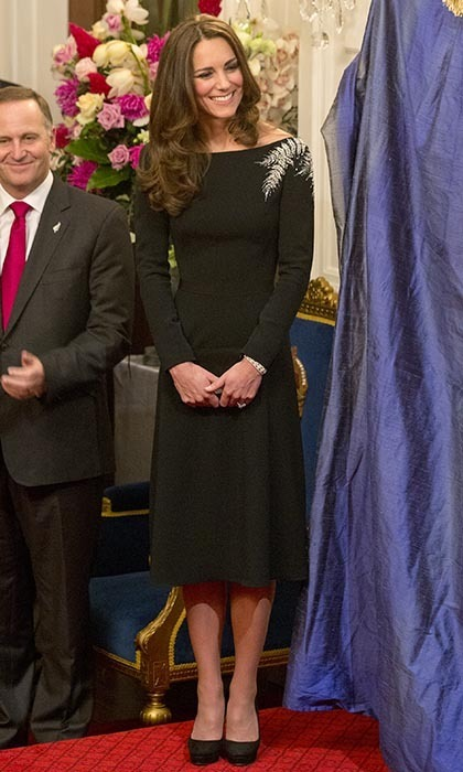 DAY 4: For lavish state reception at the government house – where she and Prince William were to unveil a portrait of The Queen – Kate wowed in a Jenny Packham LBD, which featured hand-sewn silver beading in the shape of a fern to represent New Zealand's national emblem. She wore her brunette locks in loose curls over her shoulders for the occasion. Photo: © Getty.