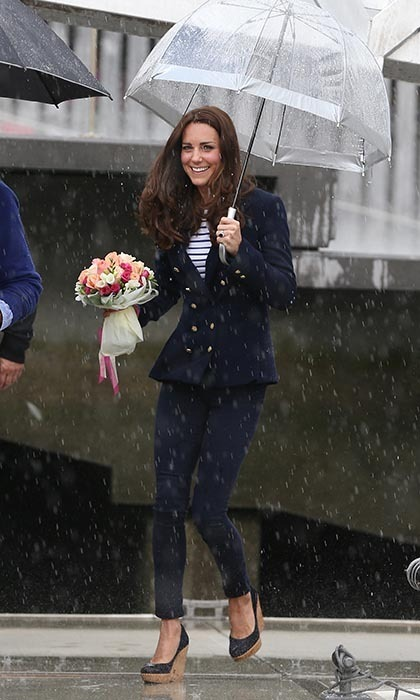 DAY 5: A dressed-down Duchess opted for a casual look while meeting with Air Force personnel and their families. She wore a double-breasted Zara jacket featuring gold buttons (with a price tag of around $146 CAN), a striped top from Me + Me and her favourite pair of Stuart Weitzman wedges. Photo: © Getty.