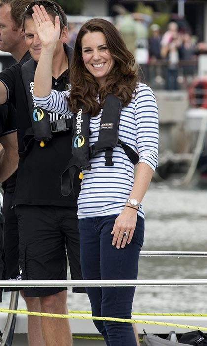 DAY 5: For a yachting race later in the day, Kate swapped in her blazer for a life vest and slipped into a pair of more practical Sebago Bala flats. She would later beat William twice at the races! Photo: © Getty.
