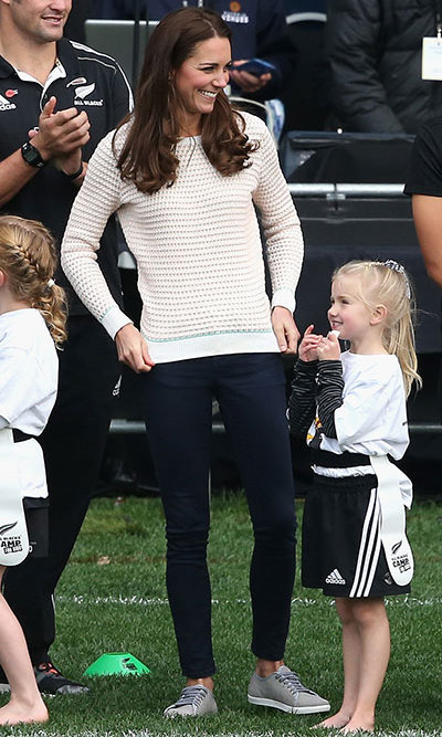 DAY 7: Kate changed out of her aquamarine Emilia Wickstead dress, opting for a cream jumper, jeans and grey trainers to help coach youngsters at rugby. Photo: © Getty.