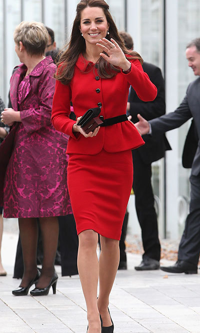 DAY 8: The Duchess chose a red Luisa Spagnoli suit cinched in at the waist by a black belt — the official colours of the region of Canterbury. She purchased the skirt suit by the Italian designer in Knightsbridge back in 2011 for $910, and first wore it during a visit to St Andrews in March of that year. Photo: © Getty.