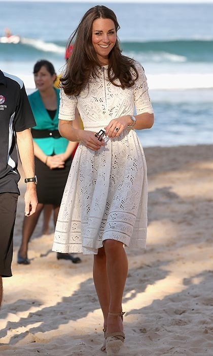 DAY 12: Kate walked on the sand at a lifesaving event on Manley Beach on April 18 in Sydney. The Duchess wore a sweet white eyelet dress by Australian designer Zimmermann and wedge sandals.