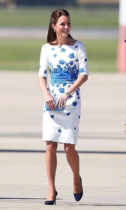 DAY 13: Dressed in L.K.Bennett's blue and white Lasa Poppy Print Dress, navy heels and carrying a vibrant blue clutch bag, Kate beamed before taking her seat in the driver's seat of the F/A-18F Super Hornet.