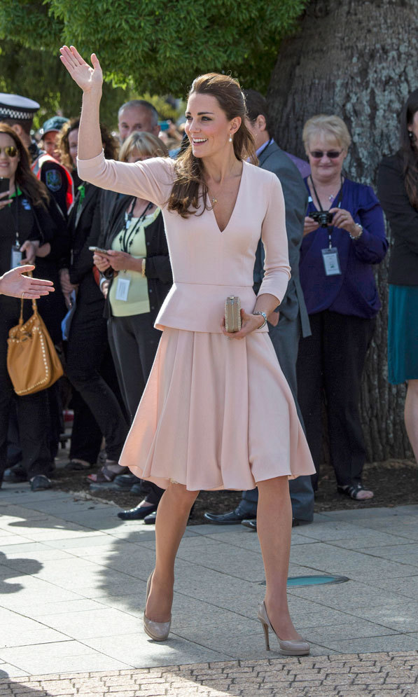 DAY 16: The elegant royal notched up another sartorial success with a soft pink, long-sleeved Alexander McQueen top featuring a v-neck and peplum detailing, teamed with a pleated A-line skirt for a trip to Elizabeth on April 22. She completed her elegant ensemble with pearl drop earrings and her trusted nude heels.